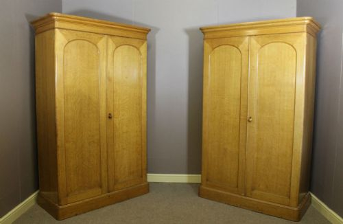 a pair of country house oak wardrobes by gillows of lancaster