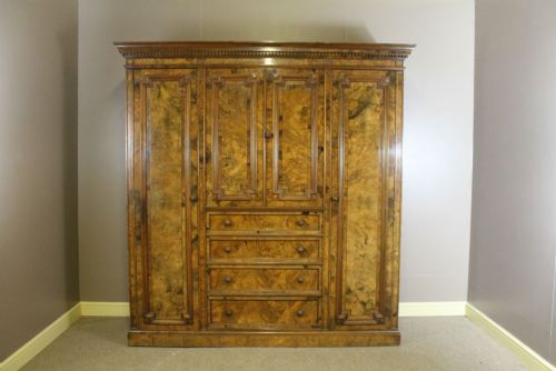 a 19th century walnut combination wardrobe of exceptional quality