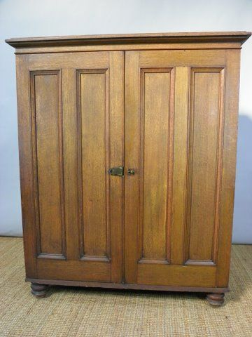 a 19th century oak storage cupboard