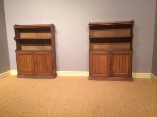 a pair of oak bookcases