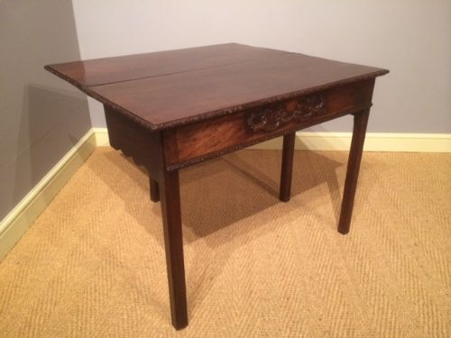 an 18th century mahogany chippendale period carved tea table