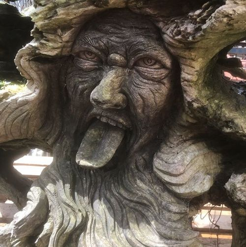 mid 20th c green man carved tree root