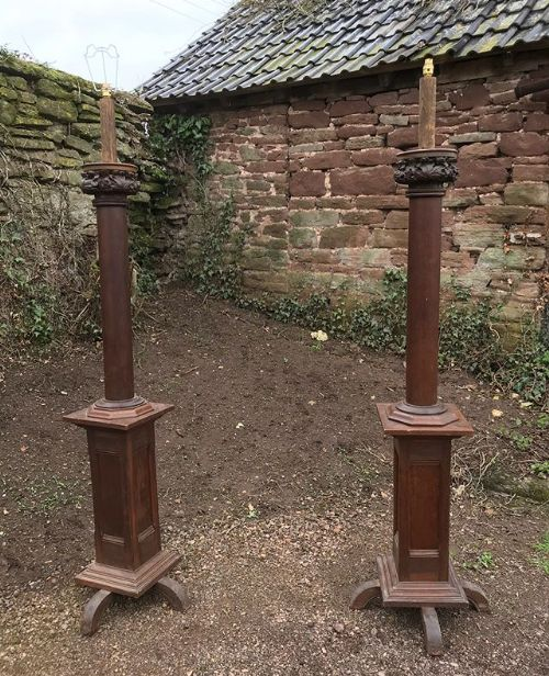 pair of 19thc freestanding carved oak lamps