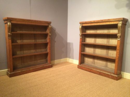 a pair of birds eye maple bookcases