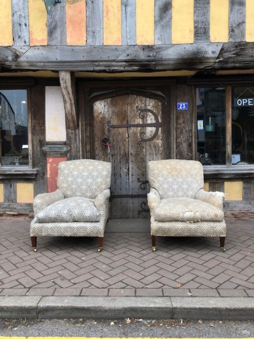a pair of deep seated grafton howard sons armchairs