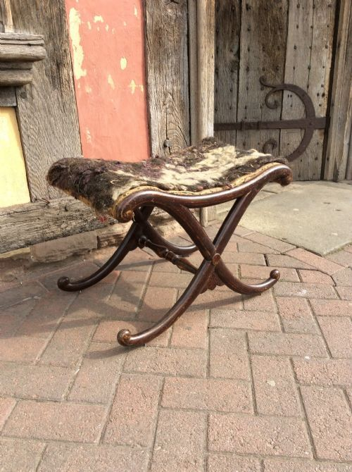 regency simulated rosewood x shaped stool