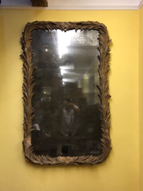 an 18thc carved pine plaster mirror
