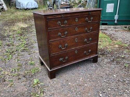 an 18thc mahogany chest of drawers with brushing slide