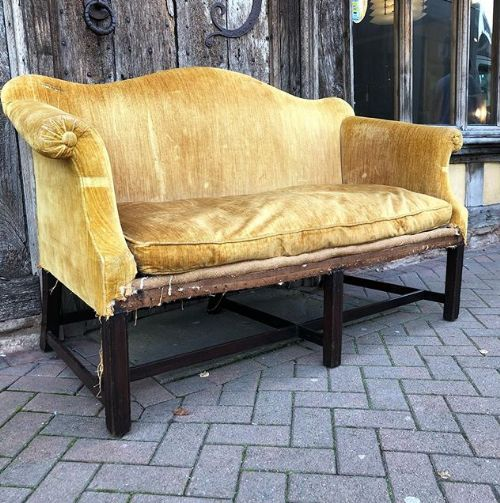 an edwardian mahogany camel back sofa