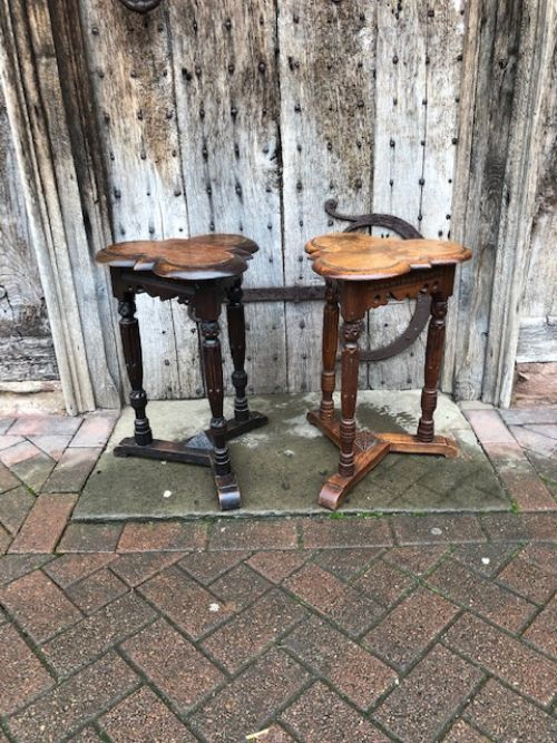 a matched pair of oak tables in the elizabethan style