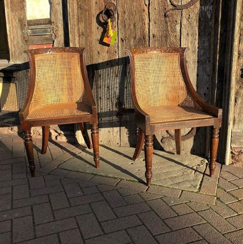 a pair of 19thc simulated rosewood caned side chairs