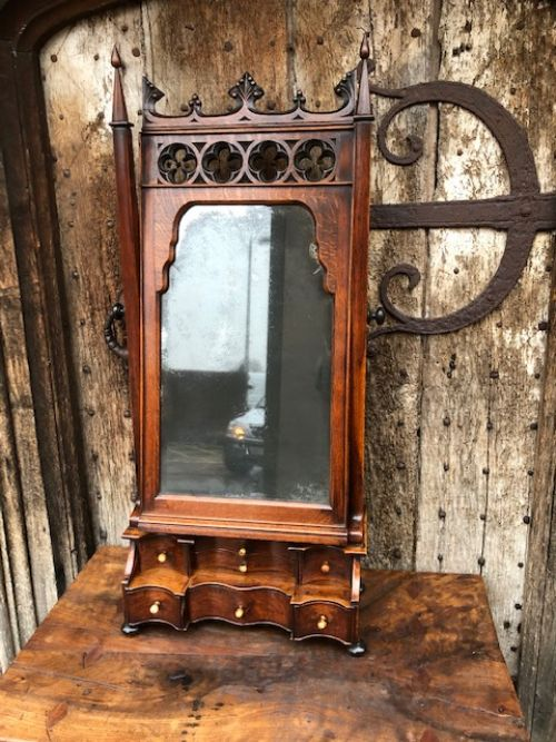 an 18thc gothic oak table mirror
