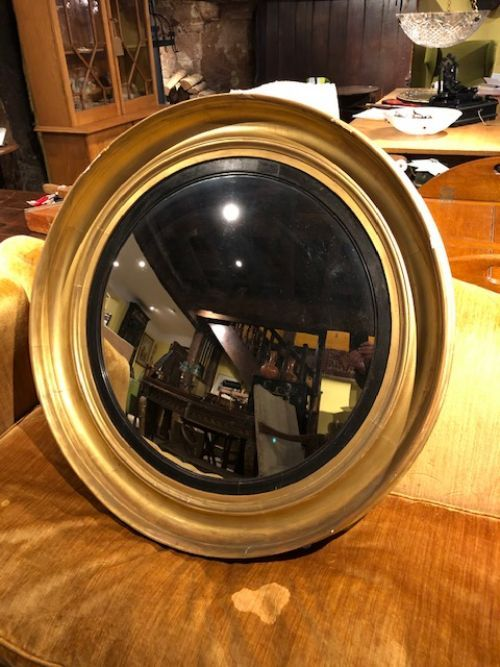 an early 19thc large gilt convex mirror with original plate