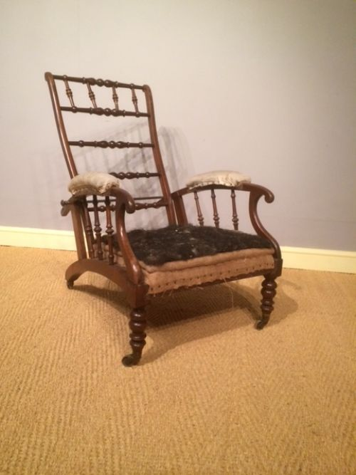 a 19th century walnut reclining country house armchair for upholstery
