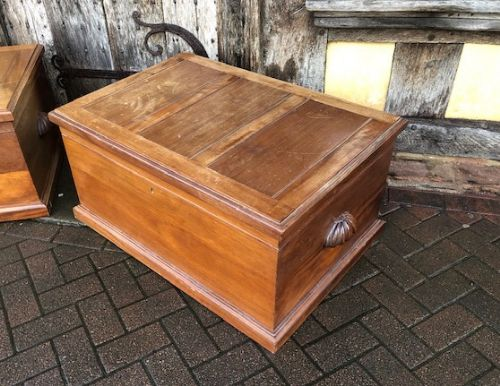 a very solid and well made mahogany trunk with carved side handles c1900