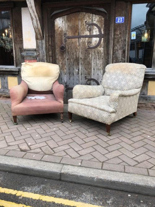 a pair of edwardian deep seated grafton model howard sons armchairs