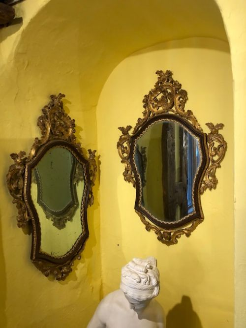 a pair of 18th century italian carved gilded and simulated mirrors