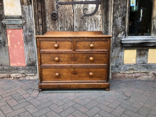 a 19thc low waisted oak chest of drawers