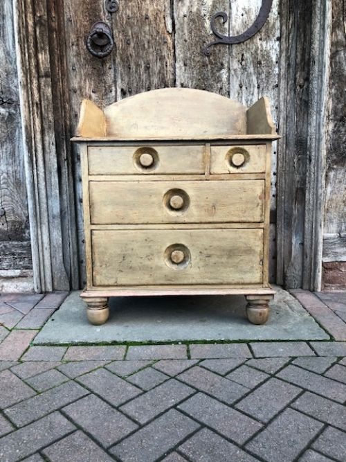 a 19th century dry scraped painted pine chest of drawers