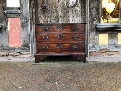 an 18thc george ii mahogany serpentine chest of drawers