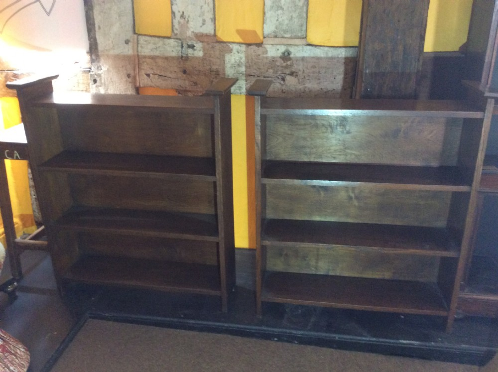 pair of oak arts crafts style open bookcases