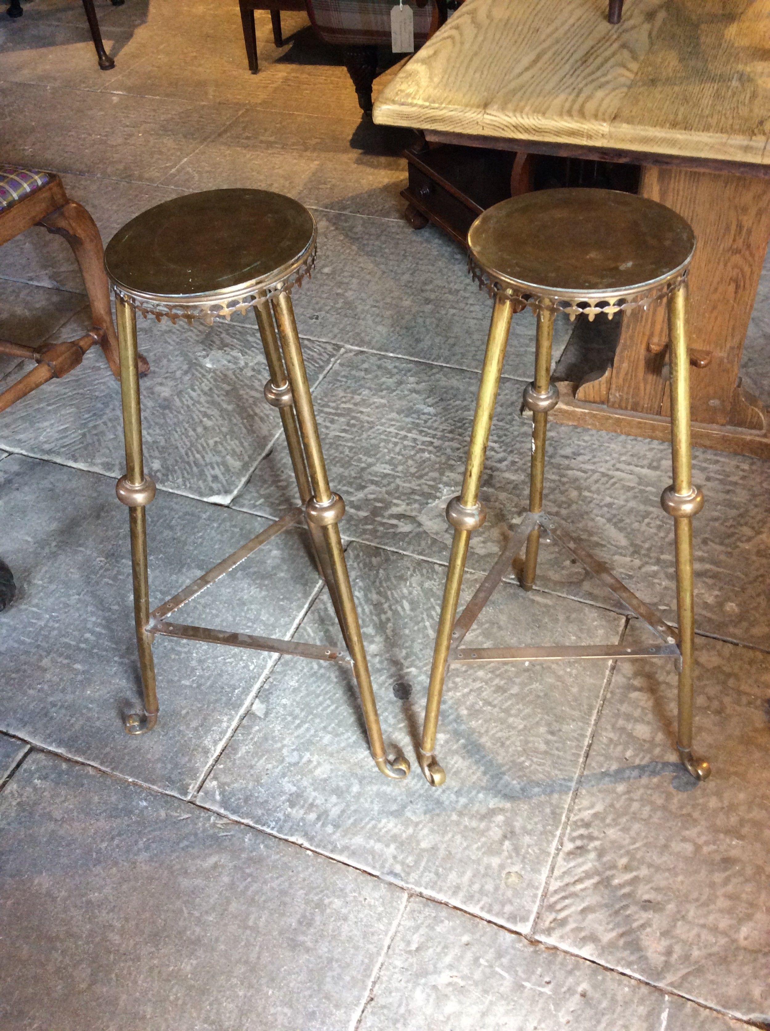 pair of arts crafts brass stands
