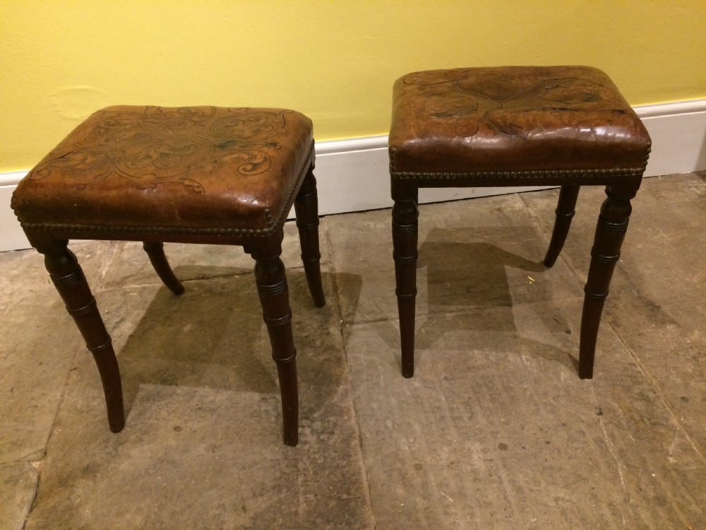 18thc pair of mahogany sabre leg and embossed leather stools