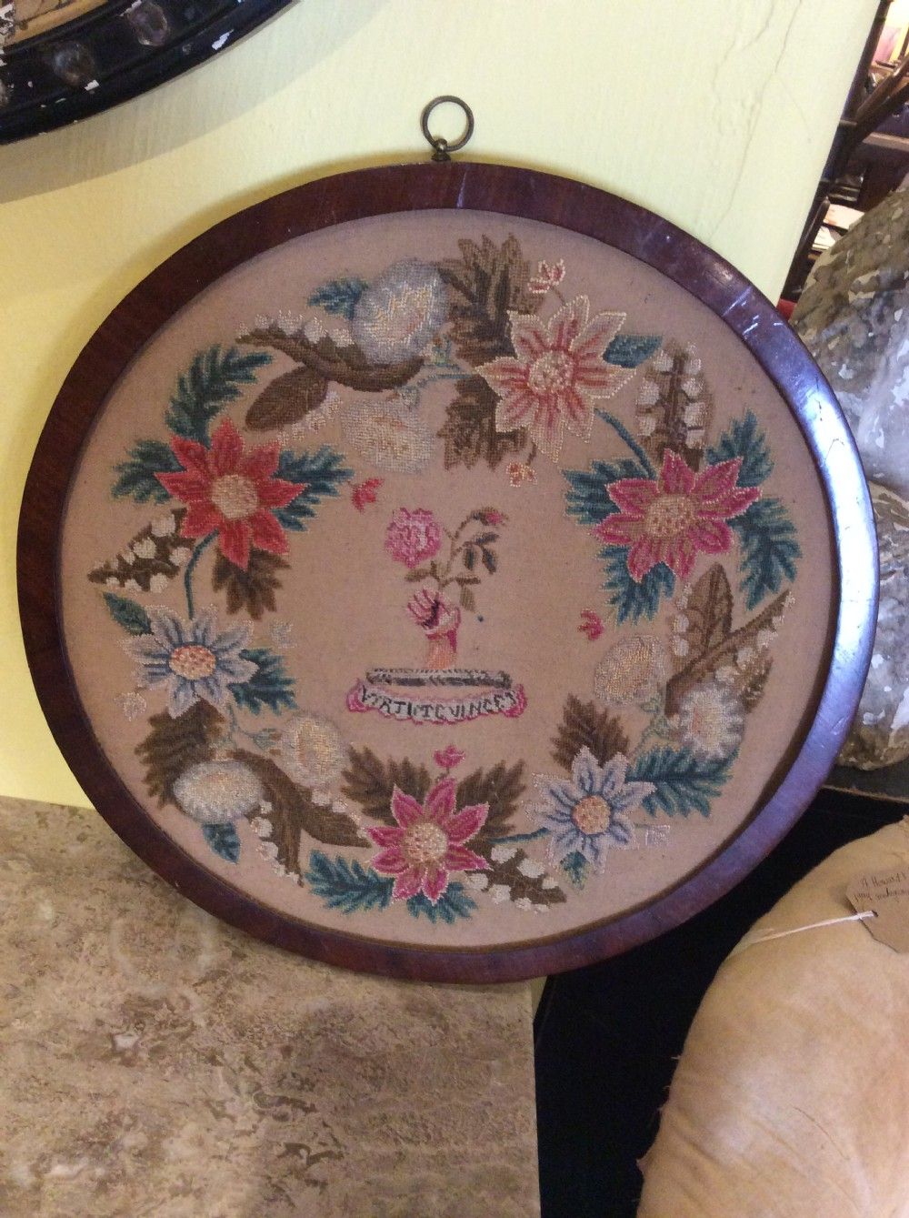 19thc mahogany circular frame with petit point tapestry of floral design