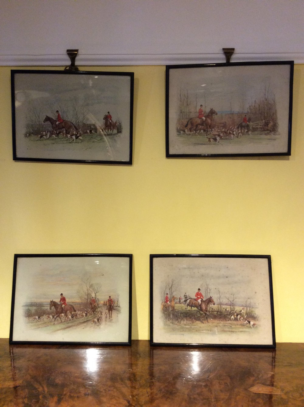 set of 4 19thc prints of crayons hunting scenes in black frames