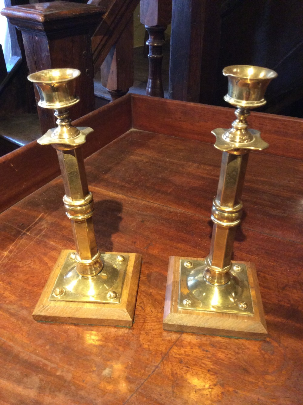 arts crafts brass candlesticks on oak base