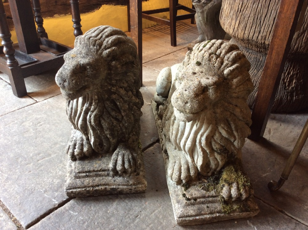 pair of reconstituted stone reclining lions