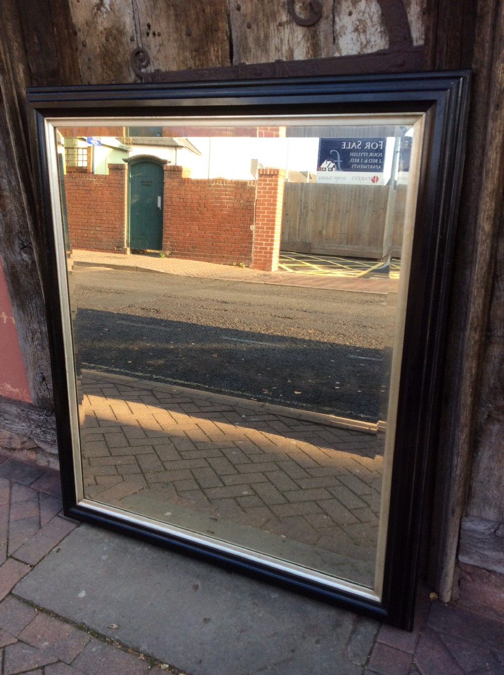19thc ebonised bevelled mirror