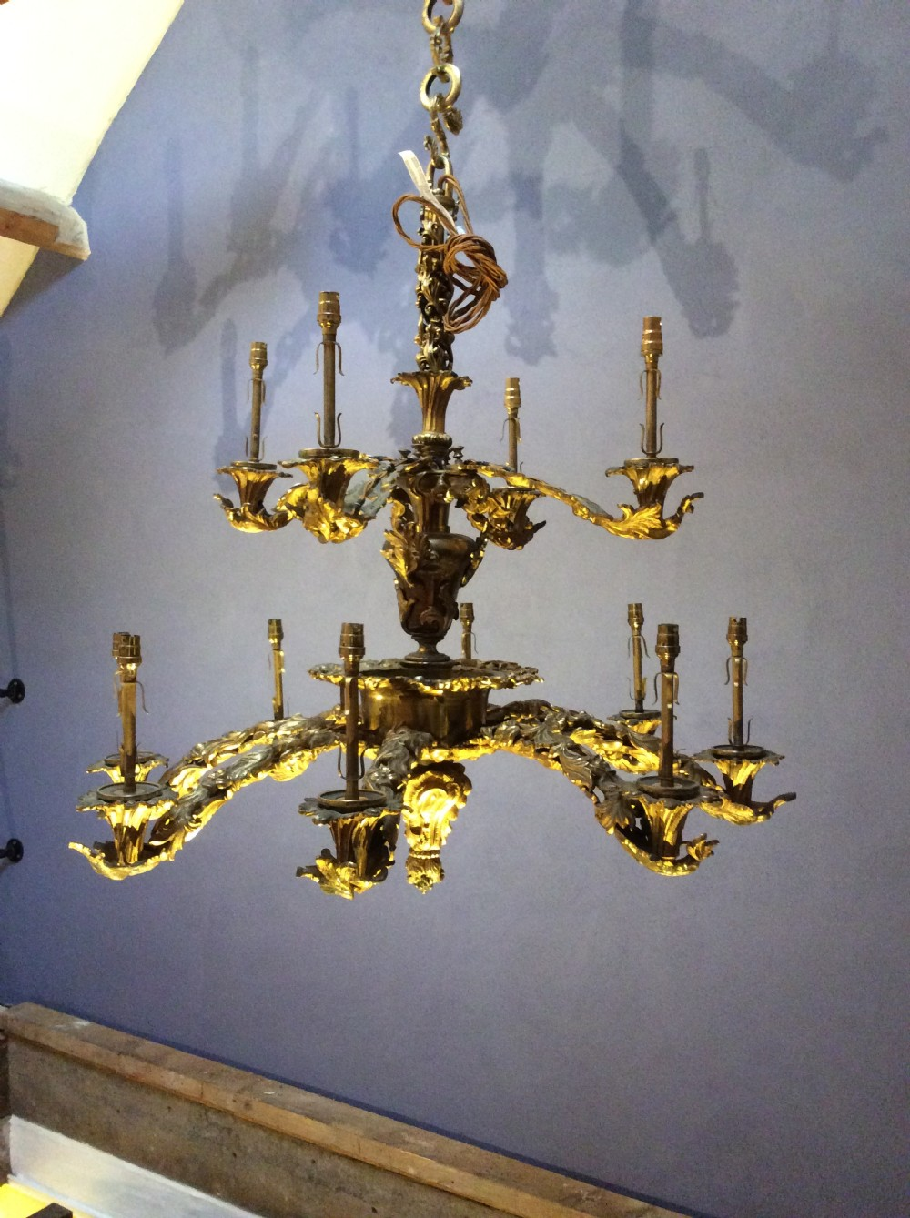 a 12 branch gilt brass chandelier