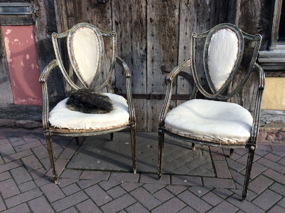 pair of early 19thc painted decorated armchairs