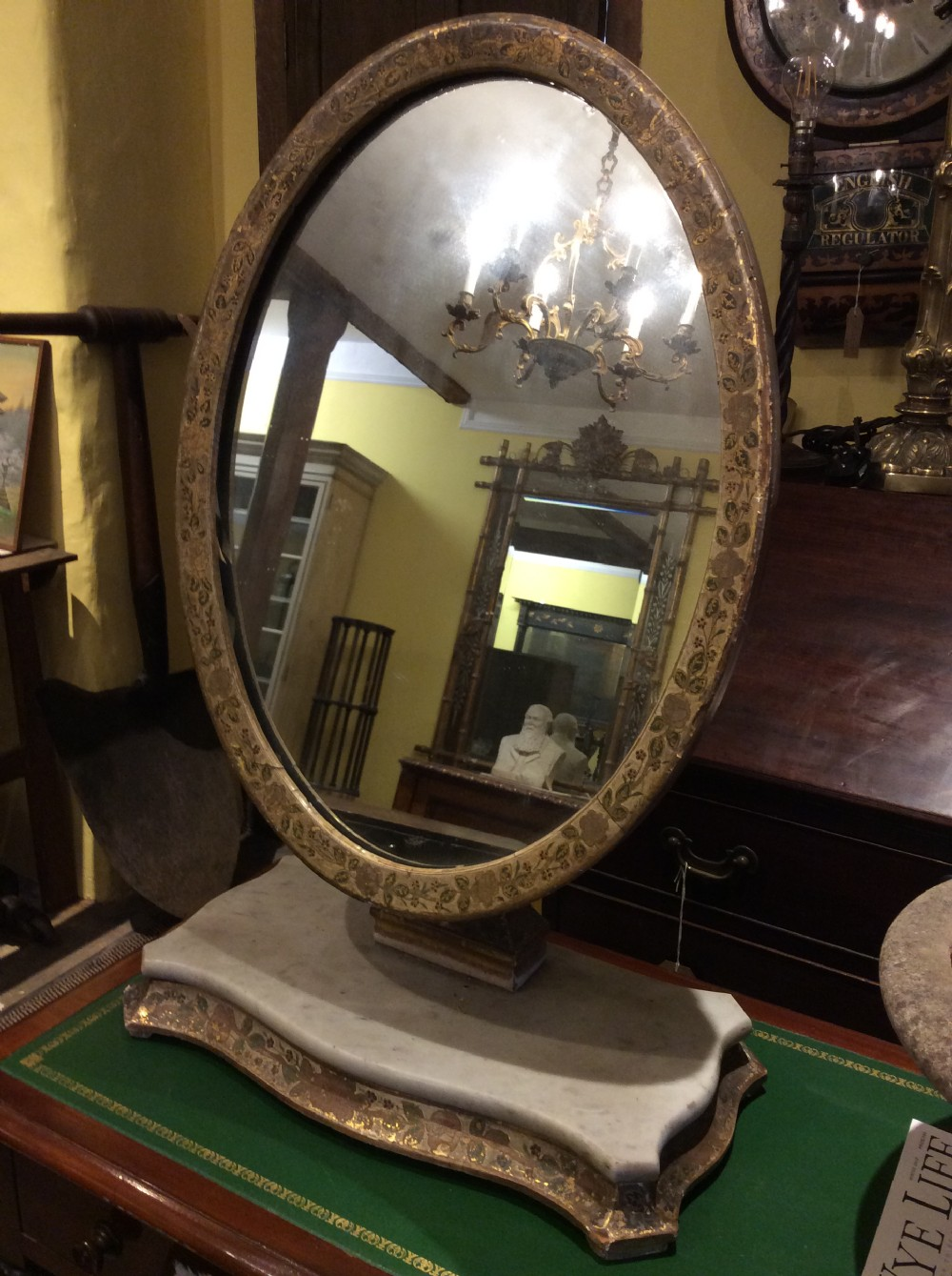 decorated tilting table mirror on marble plinth