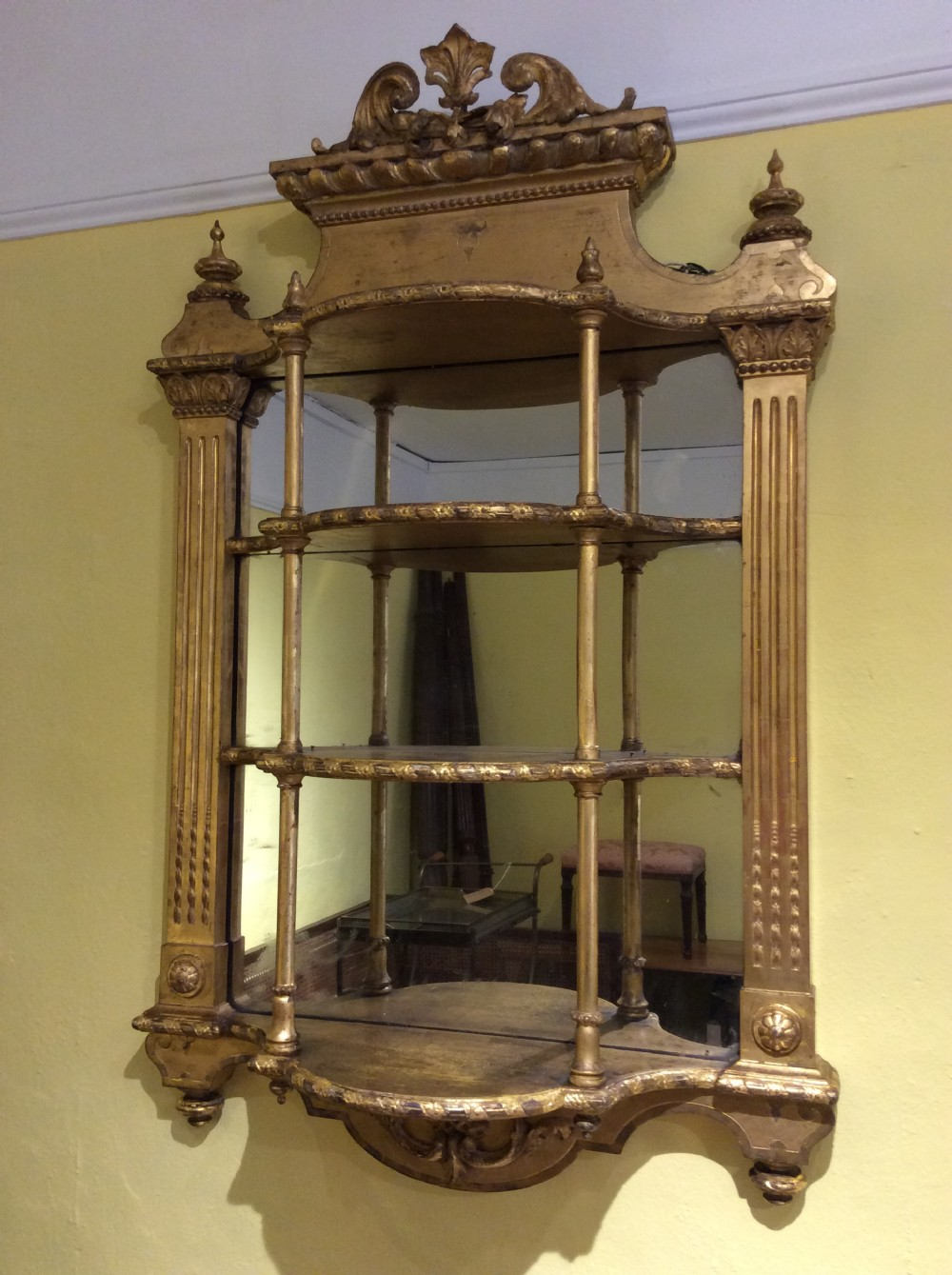 a pair of 19thc gilt mirror shelves