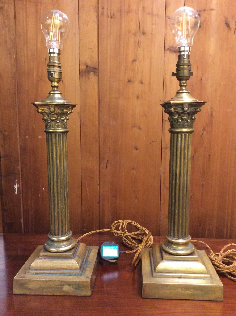a pair of edwardian brass corinthian column table lamps