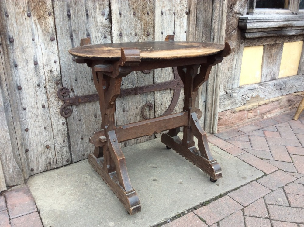an arts crafts gothic revival oak table