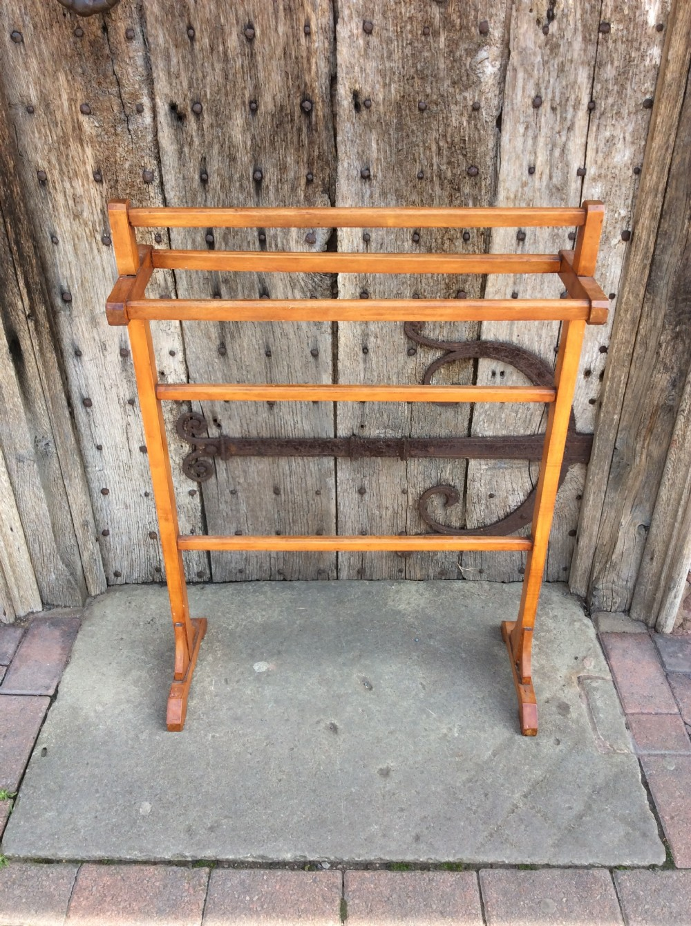 a stained beech 5 rail towel rail
