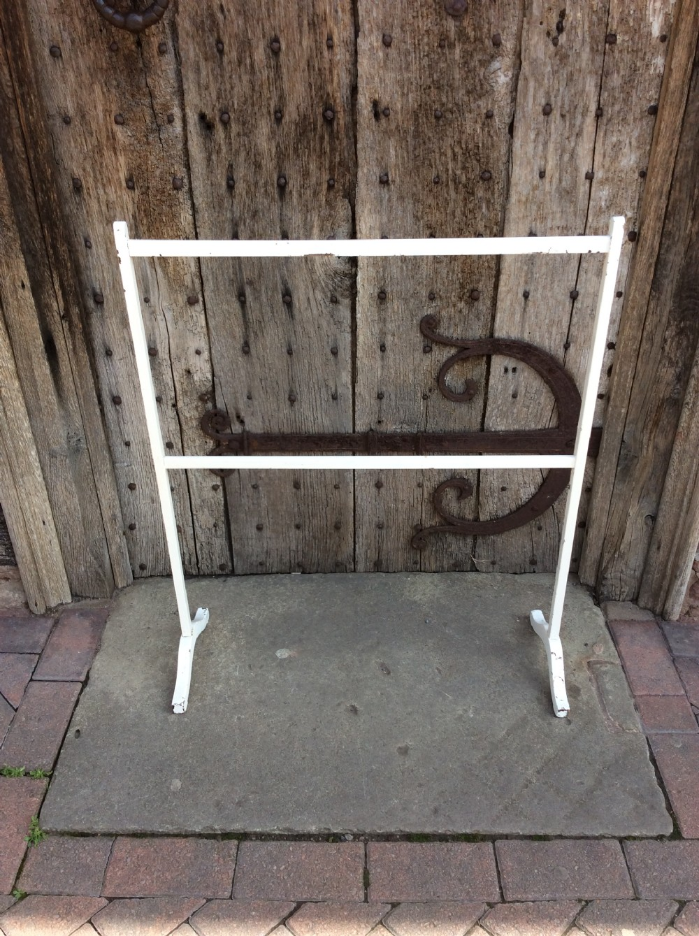 an edwardian painted towel rail