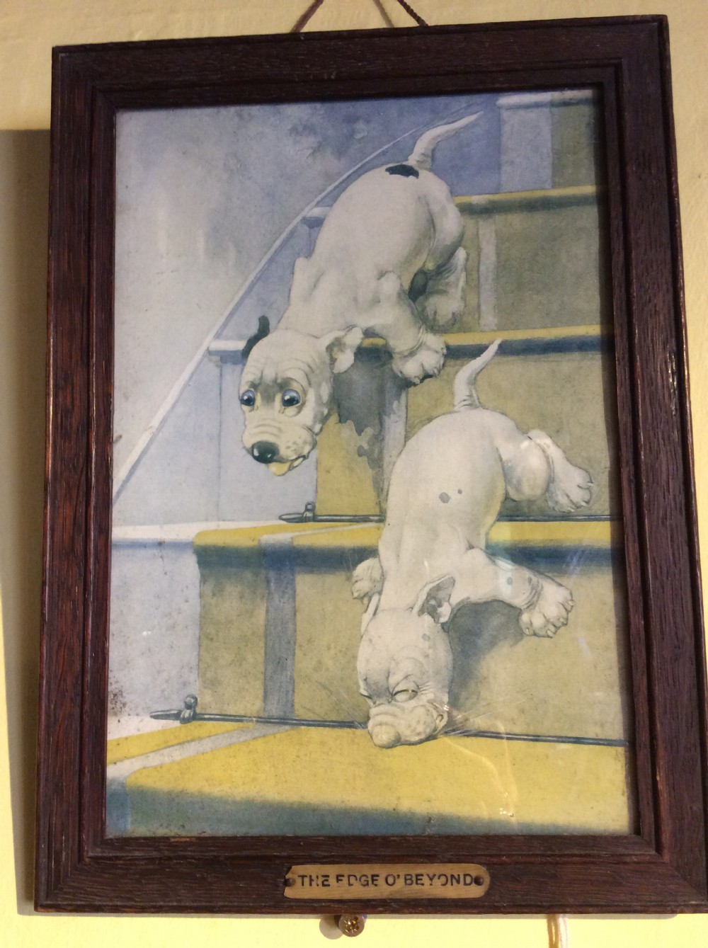 a 1920s print of two puppies in oak frame