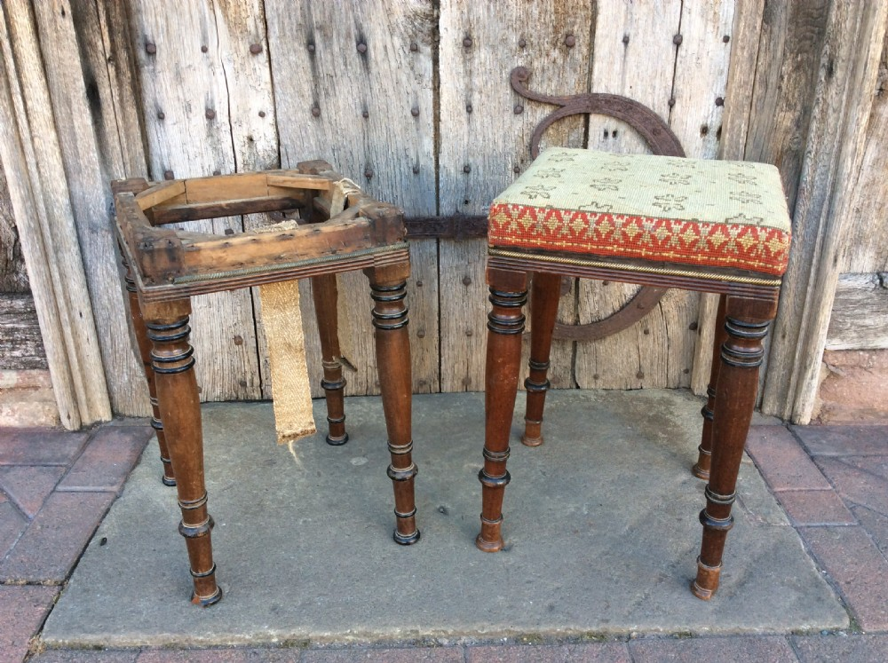 a pair of mahogany and ebonised stools c1820