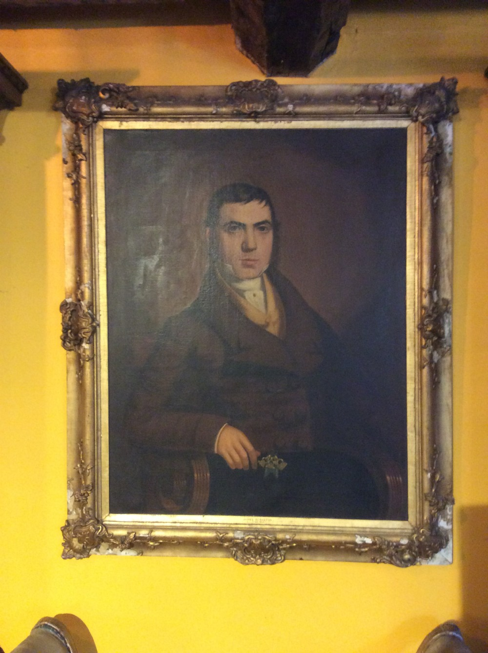 a 19thc oill painting of a man in ornate gilded frame