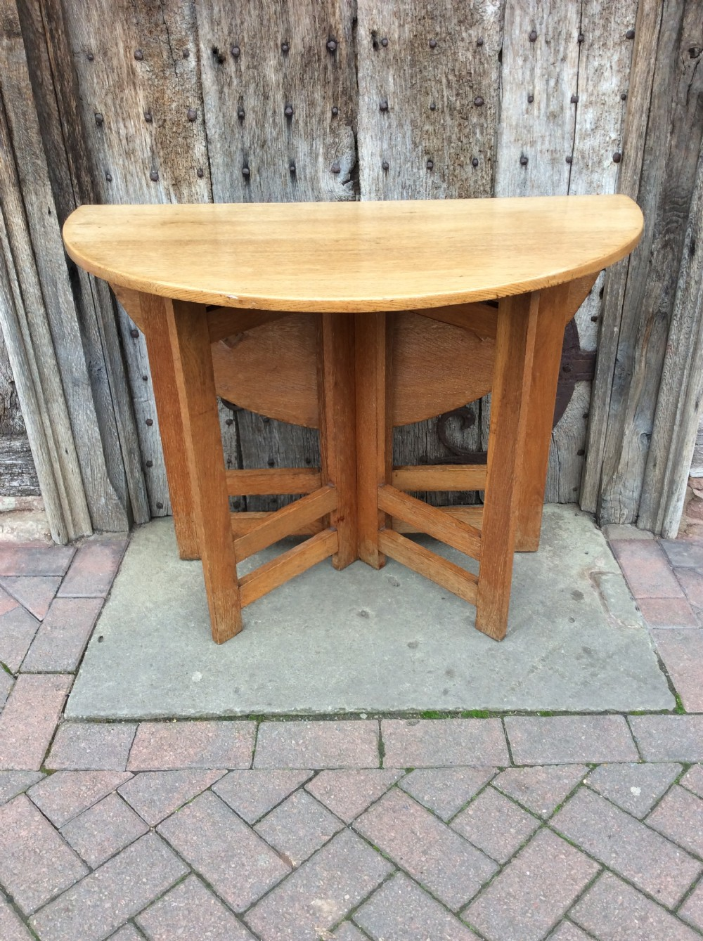 an early 20thc arts craft light oak gateleg table
