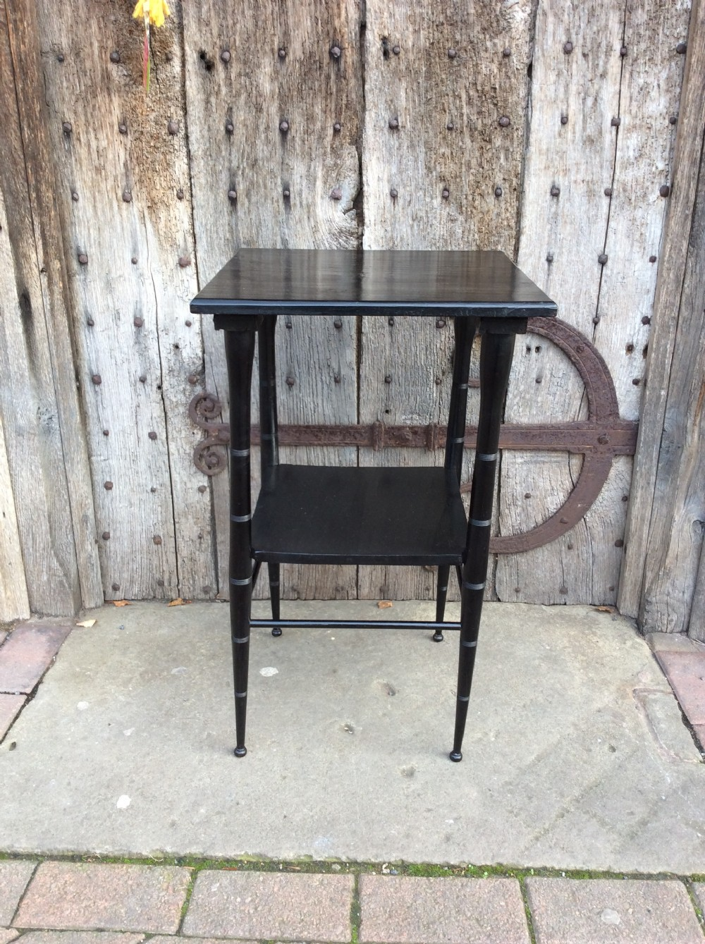 an ebonised e w godwin style lamp table