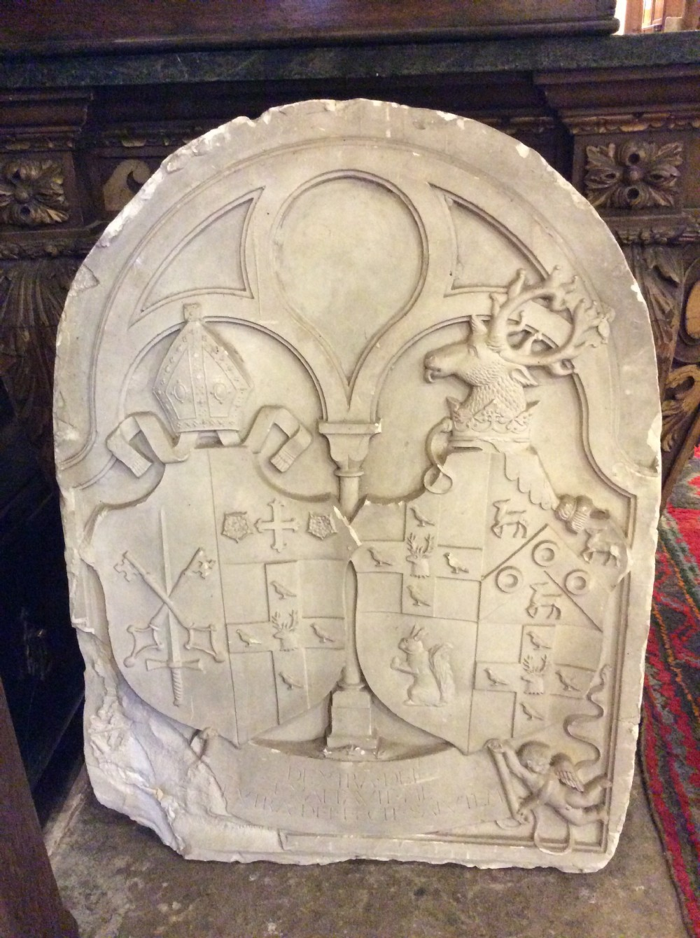 a 19thc plaster relief of a coat of arms