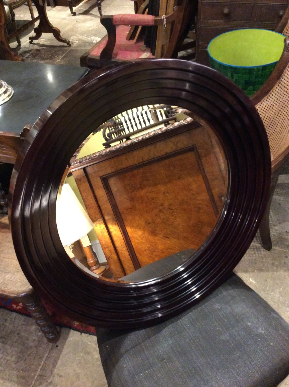 an art deco lacquered circular mirror