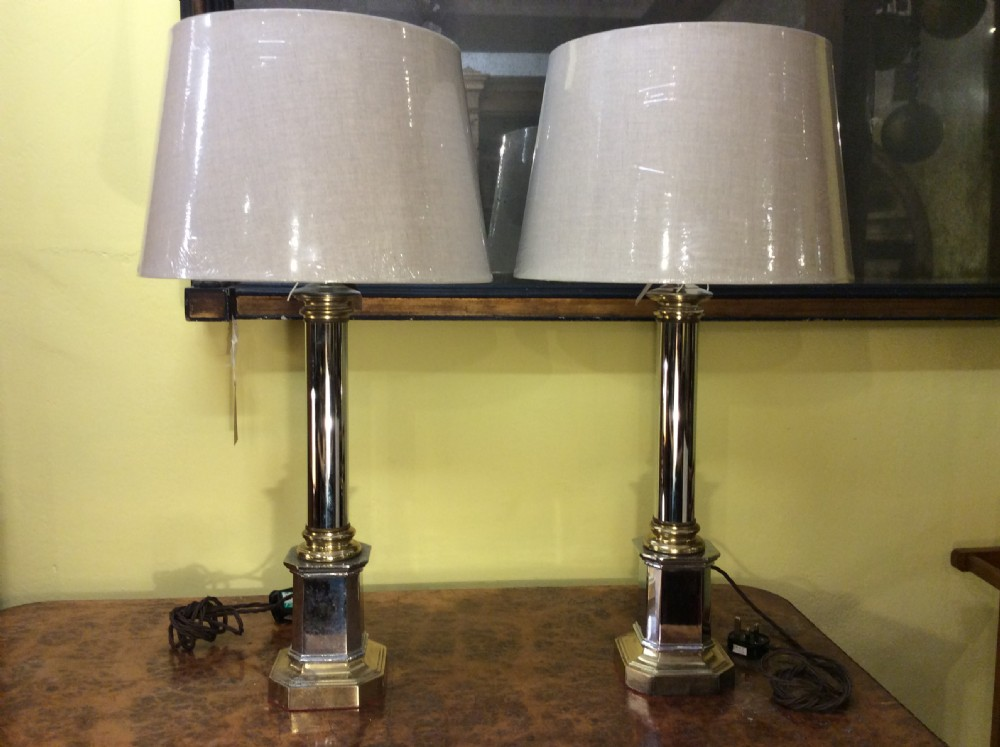 a pair of chrome and brass 1950s table lamps