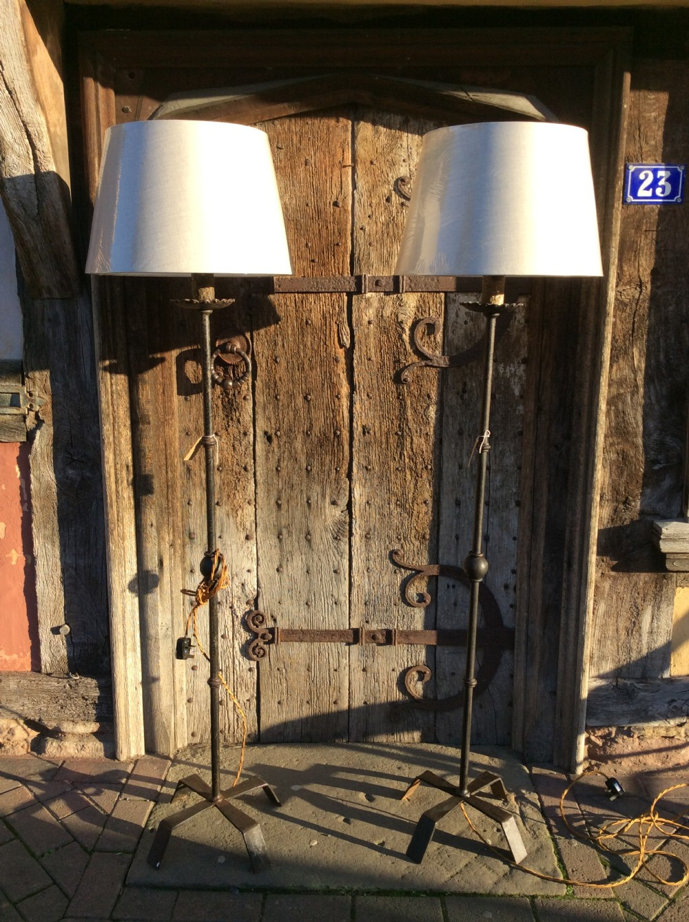 a pair of early 20thc steel standard lamps c1900