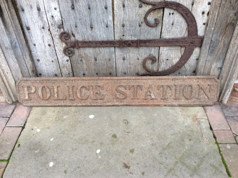 a 19thc police station sign in cast pig iron